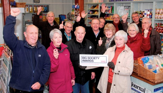 Directors and volunteers celebrate receiving the 2013 Big Society Award