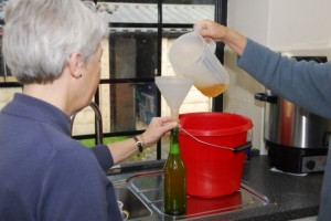 11 Sally Blanckley and Ann bottling the juice