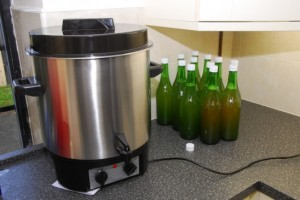 12 Bottles of juice go into the pasteuriser